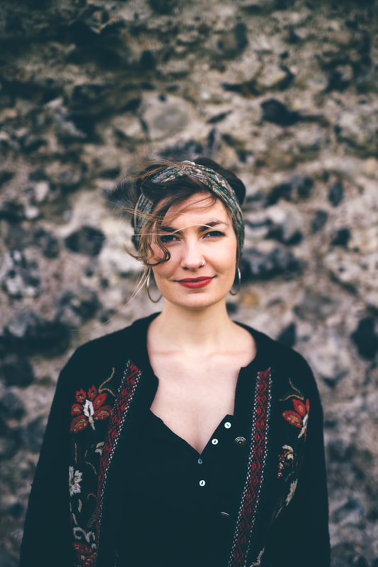 Rosie Hodgson Singer with The Wilderness Yet, Folk, UK, Festival, Band, Young, Trio, Rosie Hodgeson, Rowan Piggott, Philippe Barnes, Traditional, Harmony singing, Songs, Folksong, Modern, English, Fiddle, Guitar, Flute, Gerard Manley Hopkins, Lyric, Irish, Modern, Folk Rock, new